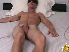 Cute straight boy gets jerked off while blind folded and shoots a load of cum.