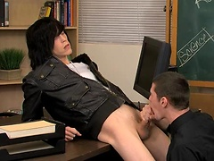 A teacher puts his twink student up on his desk and blows him.