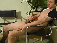 This young boy have a lot of pleasure in a simple chair!