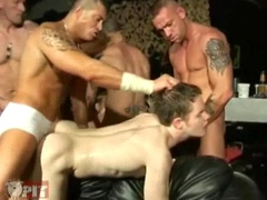 Orgy with Ashley Ryder in center being gang fucked by group of guys