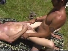 Jason drills down into Troy's upturned ass on the grass