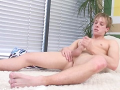 Well built twink Luke strokes his cock