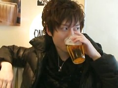 Asian twink drinking a beer