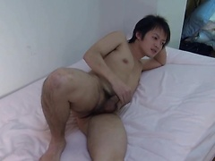 Asian boy plays with his small cock